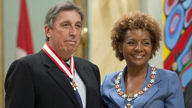 Governor General Michaelle Jean, right, invests director Ivan Reitman as an Officer of the Order of Canada during a ceremony at Rideau Hall in Ottawa, Friday September 3, 2010.