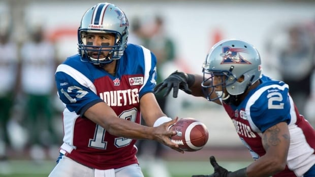 Montreal Alouettes quarterback Anthony Calvillo hands off to runningback Brandon Whitaker in a win against the Edmonton Eskimos on Thursday.