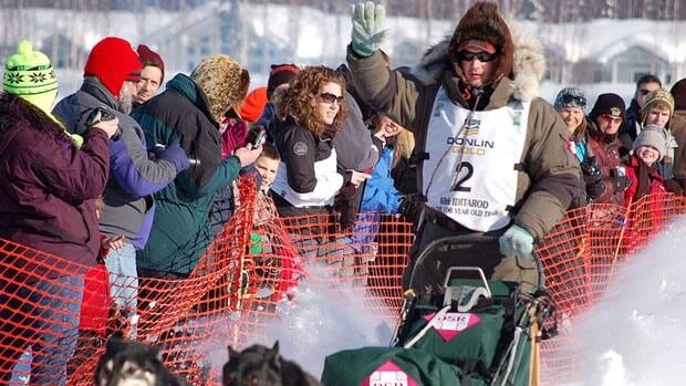 In this Sunday, March 4, 2012, photo, Ray Redington Jr. leaves as the first musher during the official start of the Iditarod Trail Sled Dog Race in Willow, Alaska. Redington was among the early leaders of the race on Monday.
