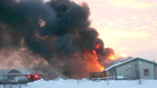 RCMP say four teenage boys are being charged with arson in connection with this fire at the Kinosao Sipi Minisowin Agency Building in Norway House, Man., on Thursday morning.