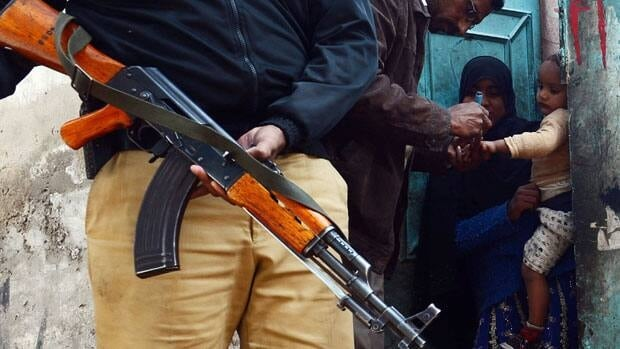 A Pakistani policeman was gunned down by assailants on motorcycles while protecting UN-backed polio workers in the mountainous village of Gullu Dheri on Tuesday.
