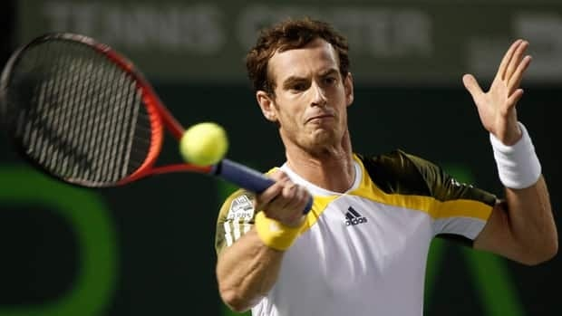 Andy Murray hits a forehand return to Richard Gasquet semifinals singles match Friday at the Sony Open.
