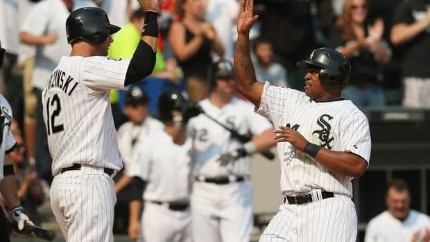 A.J. Pierzynski, left, and Dayan Viciedo of the Chicago White Sox celebrate after scoring runs against the Detroit Tigers on September 17, 2012 in Chicago.