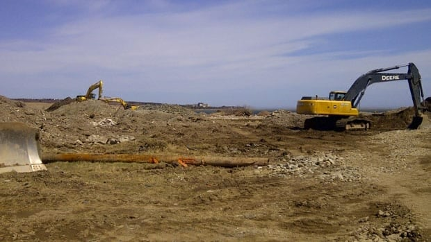 Work crews rip up what remains of the former heavy water plant in Glace Bay.