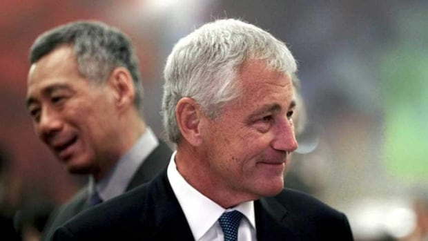 U.S. Defence Secretary Chuck Hagel, left, and Singapore's Prime Minister Lee Hsien Loong, left, at the opening of the International Institute for Strategic Studies Shangri-la Dialogue in Singapore, Friday. Hagel came ready to talk about hacking.
