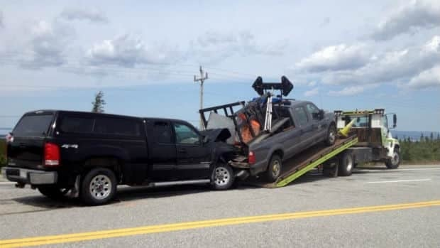 A vehicle crashed into a truck on the Trans-Canada Highway near Flat Bay.