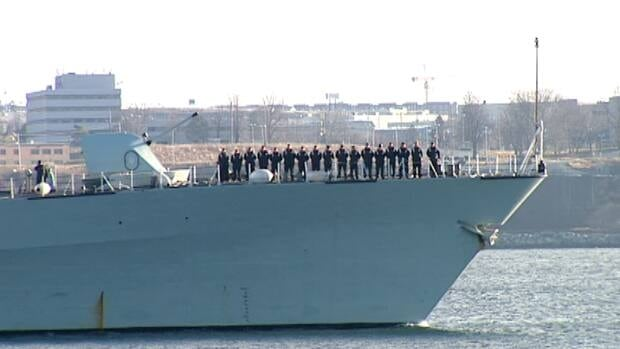 Crews line the deck of HMCS Charlottetown as it leaves Halifax Sunday.