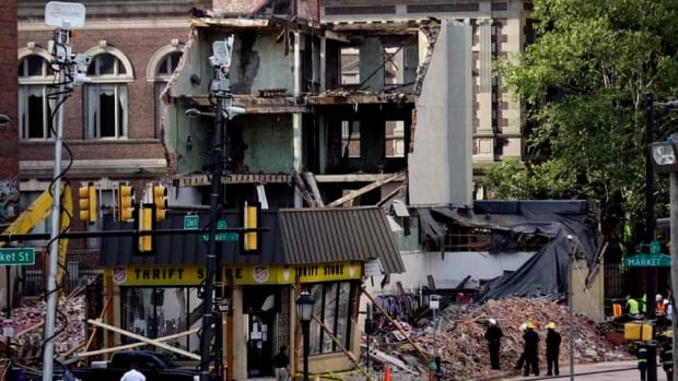 Firefighters view the aftermath of a building collapse in Philadelphia. On Wednesday, the building under demolition collapsed onto a neighboring thrift store, killing six people and injuring 14, including one who was pulled from the debris nearly 13 hours later.
