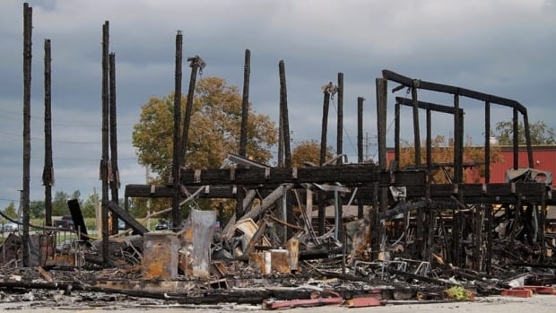 The remains of the main building at St. Jacobs Farmers' Market after a fire destroyed it early Monday morning.