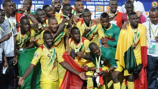 Malian players celebrate with their bronze medal at the end of the 2013 African Cup of Nations third-place match against Ghana, on February 9, 2013.