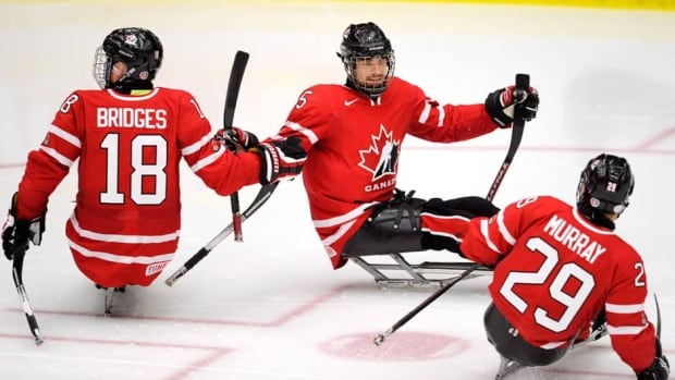 Canada's Graeme Murray, right, shown here last December, scored the game-winning goal against the United States at the Sledge Hockey World Championship in Goyang, South Korea on Saturday.