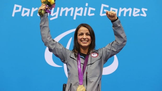 Gold medallist Victoria Arlen of the United States is seen here posing on the podium during the medal ceremony for the Women's 100m Freestyle - S6 final on day 10 of the London 2012 Paralympic Games September 8, 2012.