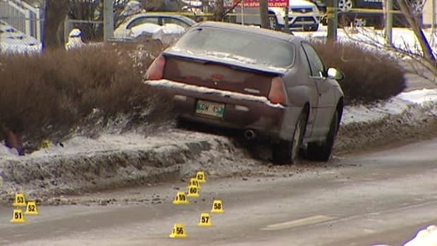 Police evidence markers are set out around the scene of a fatal crash between a cyclist and car in Winnipeg on Dec. 23.