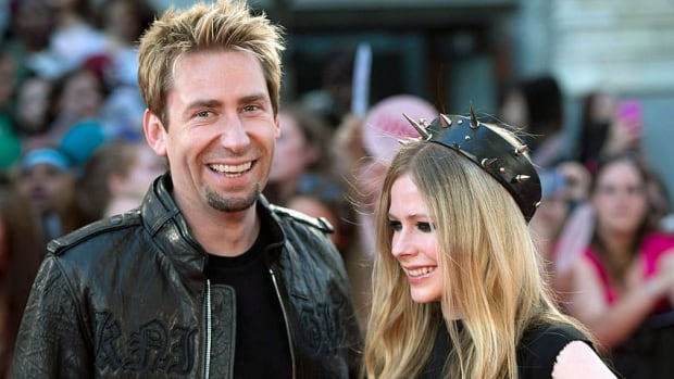 Chad Kroeger and Avril Lavigne pose on the red carpet during the 2013 Much Music Video Awards in Toronto on June 16. They married on Monday.