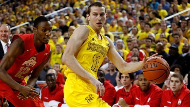 Guard Nik Stauskas, right, averaged 11.5 points per game as a freshman this season with the Michigan Wolverines.