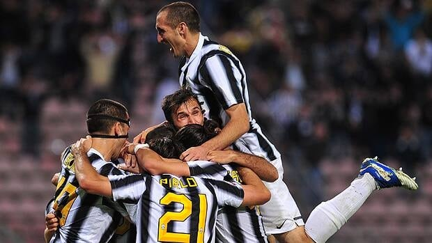Juventus defender Giorgio Chiellini (top) celebrates with teammates the end of an Italian Serie A football match against Cagliari at Nereo Rocco stadium in Trieste.