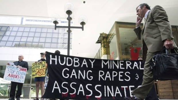 Protesters demonstrate outside the HudBay Minerals Inc. annual general meeting in Toronto on June 14. A judge ruled Monday that a group of Mayan Guatemalans can sue the company in Canadian courts.