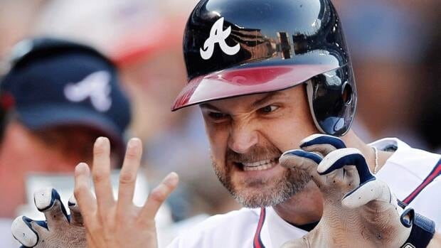 David Ross, seen here reacting after hitting a homerun for the Atlanta Braves on Oct., 5, 2012, has signed a two-year, $6.2 million US deal with the Boston Red Sox.