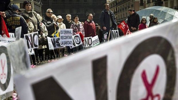 Thousands demonstrate against education and health care spending cuts in Madrid, Sunday. Tens of thousands of people across Spain are protesting education and health care spending cuts as the country slides into its second recession in three years.