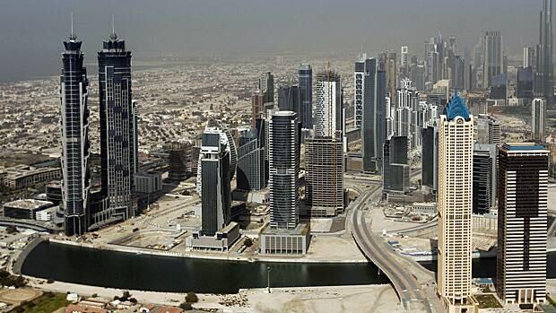 Skyscrapers are seen in Dubai. Barclays Capital says a skyscraper boom in Asia heralds economic problems to come.