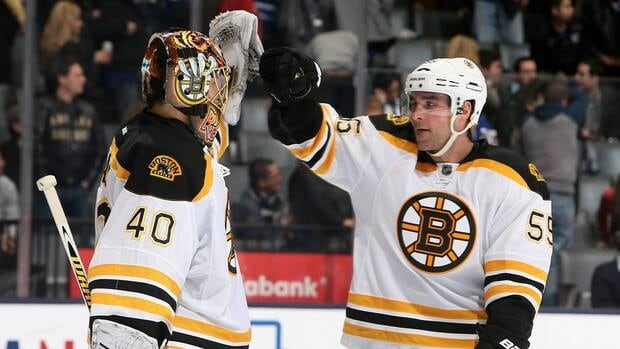 Tuukka Rask, left, and Johnny Boychuk of the Boston Bruins celebrate the win against the Toronto Maple Leafs February 2, 2013 in Toronto.