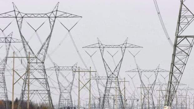 Hydro Quebec power lines are shown on Oct. 29, 2009 in Levis Que. A study conducted for the Nova Scotia government says buying electricity from the proposed Muskrat Falls hydroelectric project would be $402 million cheaper than importing it from Quebec.