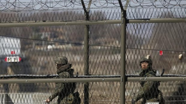 South Korean soldiers patrol along a barbed-wire fence near the demilitarized zone (DMZ), which separates the two Koreas, in Paju, north of Seoul earlier this month. South Korea and the United States have signed a new military plan.
