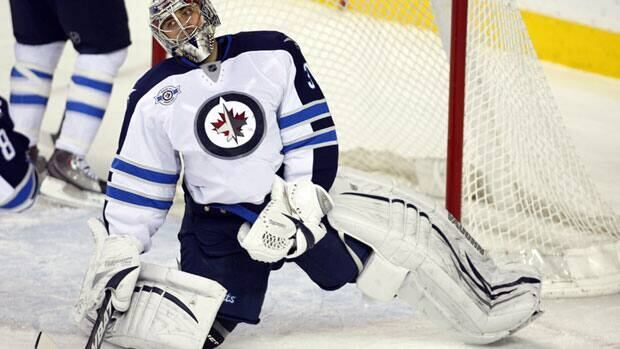 Winnipeg Jets goalie Ondrej Pavelec reacts to letting in a goal during a game against the Calgary Flames on March 9. Pavelec, who is from the Czech Republic, has been charged with impaired driving in connection with an incident in May, according to a news report in that country.