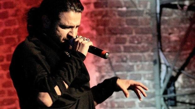 Iranian rapper and poet Shahin Najafi, seen performing in Germany, has gone into hiding after receiving death threats since the release of a new satirical song critical of Iran.