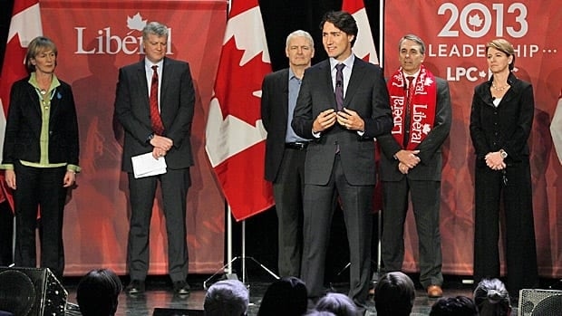 Liberal Party candidate Justin Trudeau speaks while Joyce Murray, moderator Harvey Locke, Marc Garneau, David Bertschi and Martha Hall Findlay listen in at the Liberal Party of Canada leadership debate in Winnipeg, Feb. 2. The deadline for voter registration in the race is March 14.