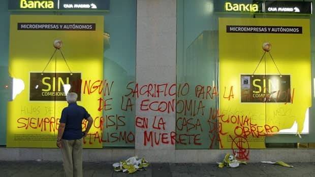"""Kill capitalism,"" is one of several slogans scrawled by protestors on a bank in Madrid on Saturday. Spain is waiting for audits of its banks before deciding how much of a €100 billion EU rescue loan to tap."