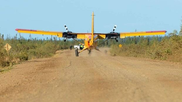 A Royal Canadian Air Force Twin Otter lands on the Dempster Highway west of Tsiigehtchic, N.W.T., during Operation Nanook 2012.