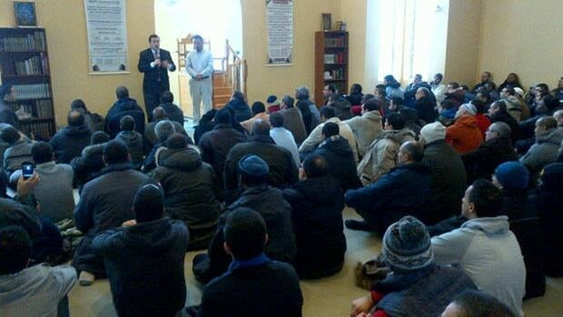 Citizenship minister, Gatineau's mayor and a number of police officers attended a prayer service at the vandalized Gatineau mosque Friday to show solidarity with the community.