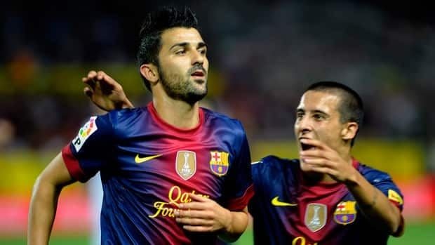 Barcelona forward David Villa, left, celebrates after scoring in extra time against Sevilla on Saturday.