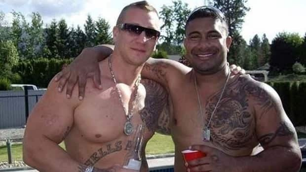Randynesh Naicker, right, stands with Larry Amero, a full-patch Hells Angels member. Amero was critically wounded in the crossfire when Jonathan Bacon, of the Red Scorpions gang, was killed by gunmen in Kelowna in August.