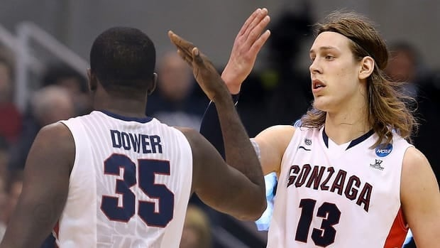 Kelly Olynyk, right, and Sam Dower of the Gonzaga Bulldogs celebrate in the second half against Southern University.