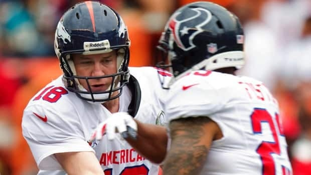 Peyton Manning hands off to Arian Foster for the AFC in the most recent Pro Bowl in Honolulu.