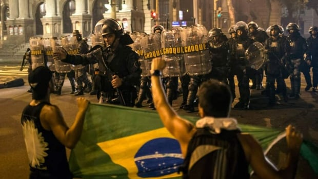 Riot police move toward some of the estimated 300,000 protesters who filled the streets of Rio de Janeiro on Thursday night.