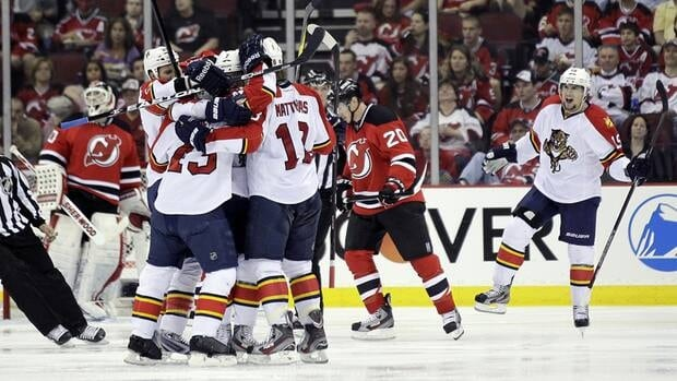 The Florida Panthers celebrate a goal by Mike Weaver during the second period of Game 3 against the New Jersey Devils on Tuesday night.