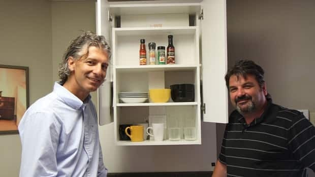 Lusso Living's Peter Rupcic and Jerry Sorbara show off a lift cabinet (all technology smartly conceled) in their Hamilton mountain showroom.