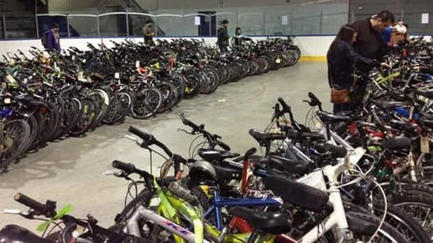 People checking out the bikes at Winnipeg's bicycle auction.
