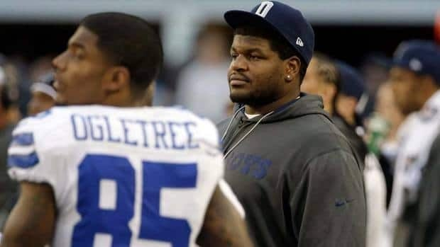 Dallas Cowboys suspended player Josh Brent watches action on the sideline against the Pittsburgh Steelers during the first half of an NFL football game on Dec. 16. He was indicted last week for one count of intoxication manslaughter.
