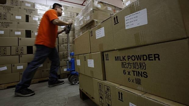 Boxes of baby formula are unloaded at the warehouse of a distributer in Hong Kong on Friday, the day new controls on the product were imposed by the government with the goal of cracking down on parallel trading in China.