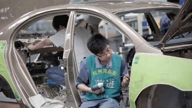 Workers assemble an automobile at Geely Cixi Manufacture Base in Cixi, China, in June 2012. China's purchasing managers' index, a measure of manufacturing activity, fell to a nine-month low in August. Analysts say that this contributed to the weak economic growth that lead to lower fuel consumption and a decrease in oil prices.
