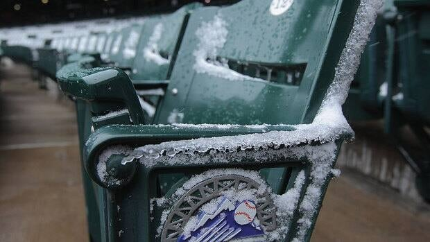 Snow coats the empty seats after Monday's game between Atlanta and the hometown Colorado Rockies was postponed due to snow. The weather wasn't much better Tuesday as the game-time temperature to open a day-night doubleheader was -5 C.