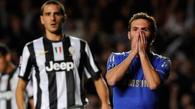 Chelsea's Juan Mata, right, reacts to his missed chance to score against Juventus during their Champions League group E soccer match on Wednesday.