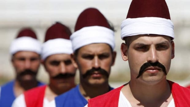 Lip ticklers, like these seen on Turkish soldiers wearing Ottoman sailor outfits, remain popular in Turkey.