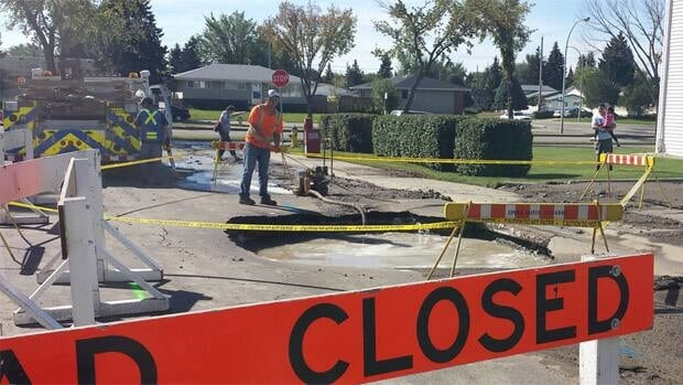 Crews work on fixing a water main break at 151st Street and 87th Avenue.