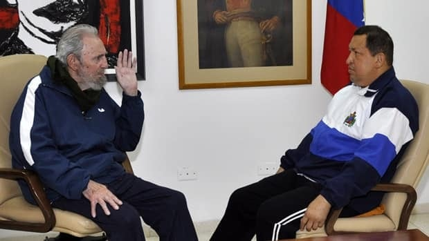 Cuba's Fidel Castro, left, speaks to Venezuela's President Hugo Chavez at a hospital in Havana, Cuba, in March 2012. Chavez is said to be recovering favourably from surgery in Cuba.