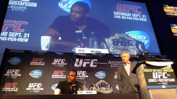 "Light-heavyweight champion Jon ""Bones"" Jones, left, and director of UFC operations in Canada, Tom Wright, answer questions at a UFC 165 press conference in Toronto on Tuesday."